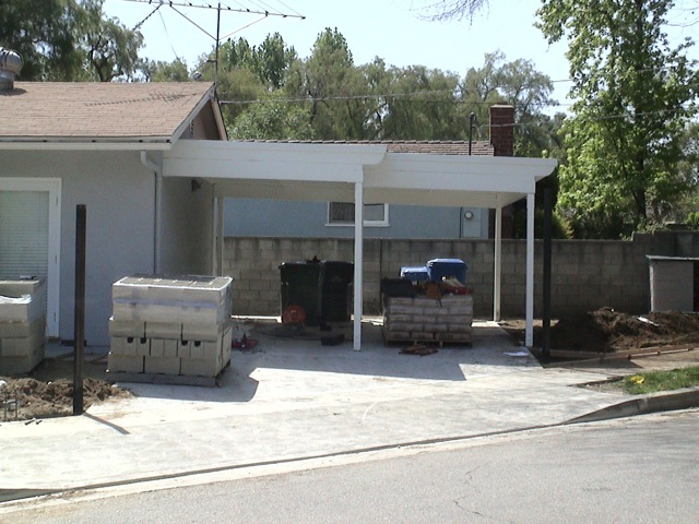 construction of a new carport next to a converted garage